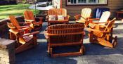 Click to enlarge image Glider Heaven: 2 Love Seat Gliders, 6 Big Boy Adirondack Chair Gliders around a fire pit. - Redwood Collection - Our redwood collection is elegant, luxurious and simply beautiful.